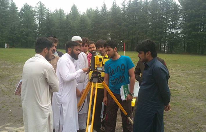 Students taking readings of Total Station during Topographic Survey